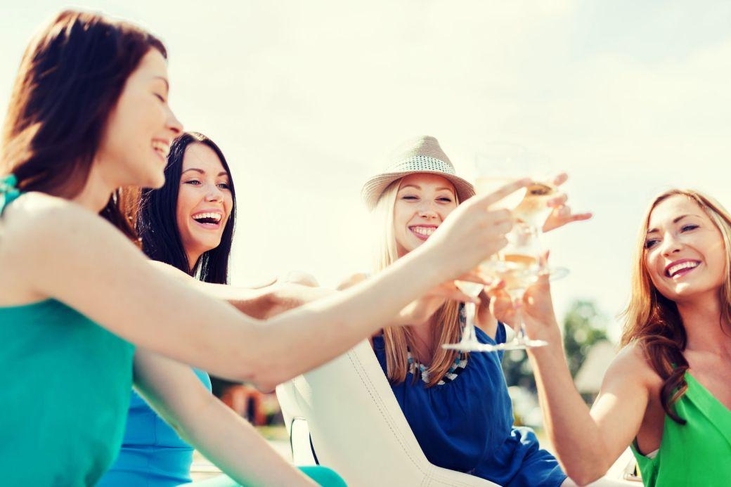 Girls drinking wine on a luxury yacht charter