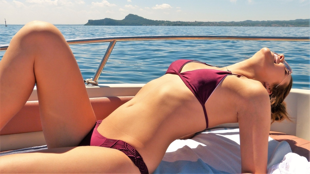 Girl in bikini on yacht charter